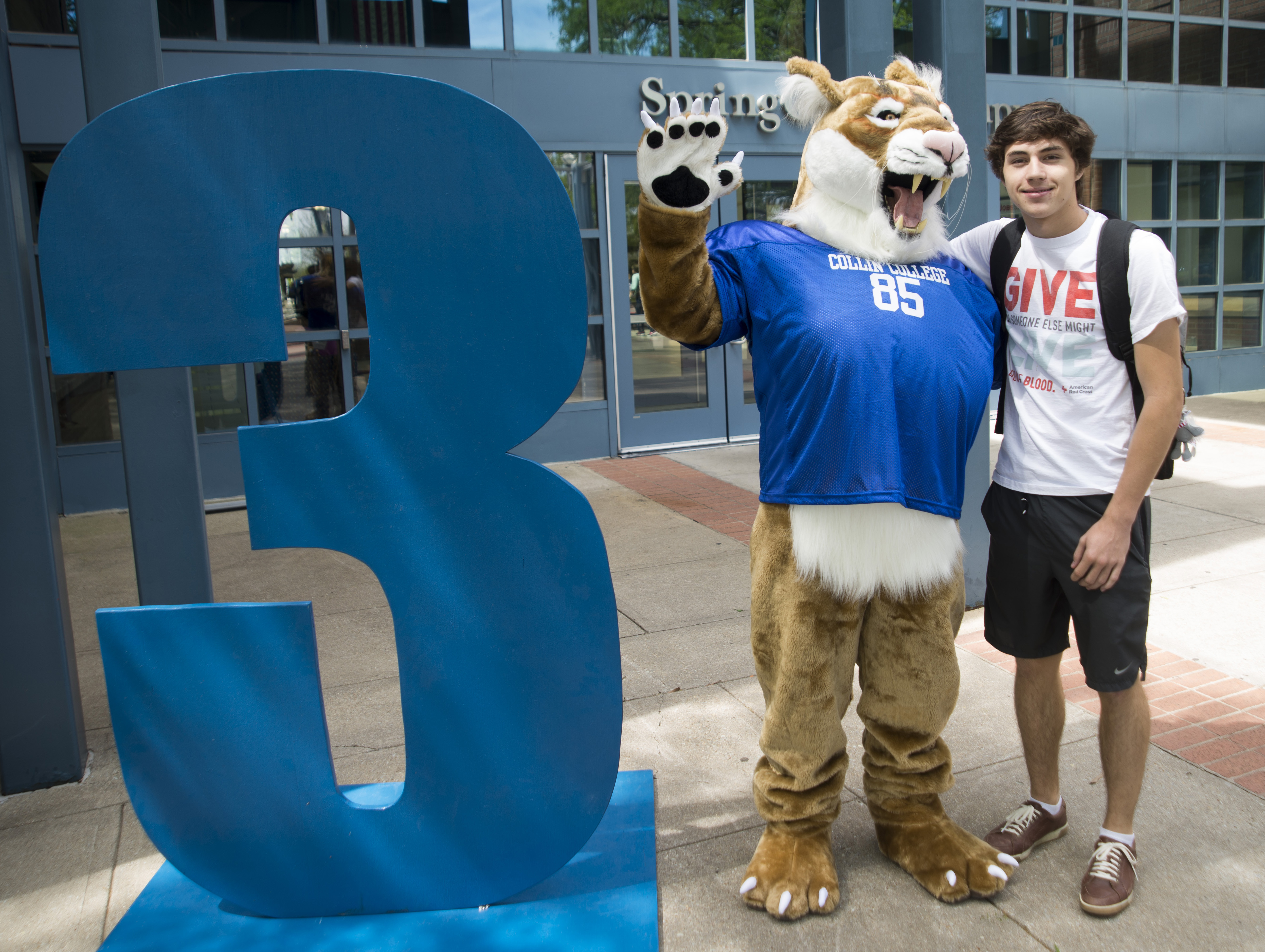 Collin Cougar with student