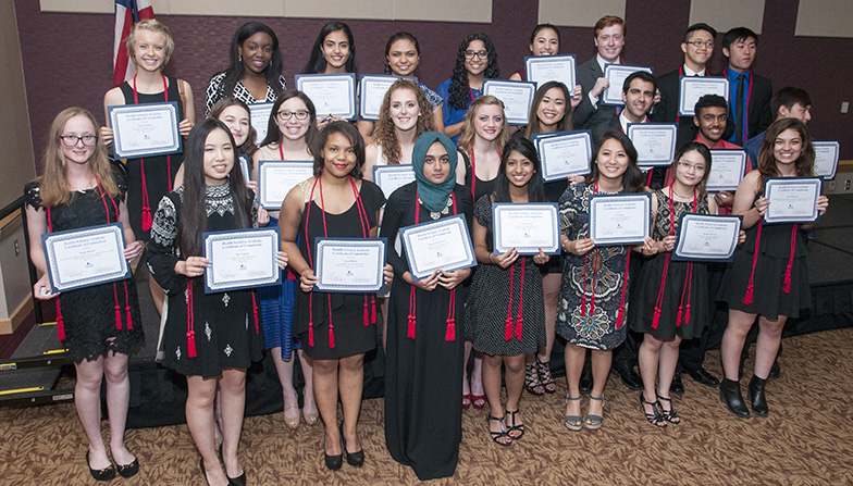 The Health Sciences Academy inaugural graduates hold up their certificates of completion.