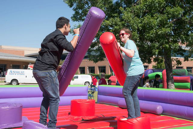 Students jousting with foam batons