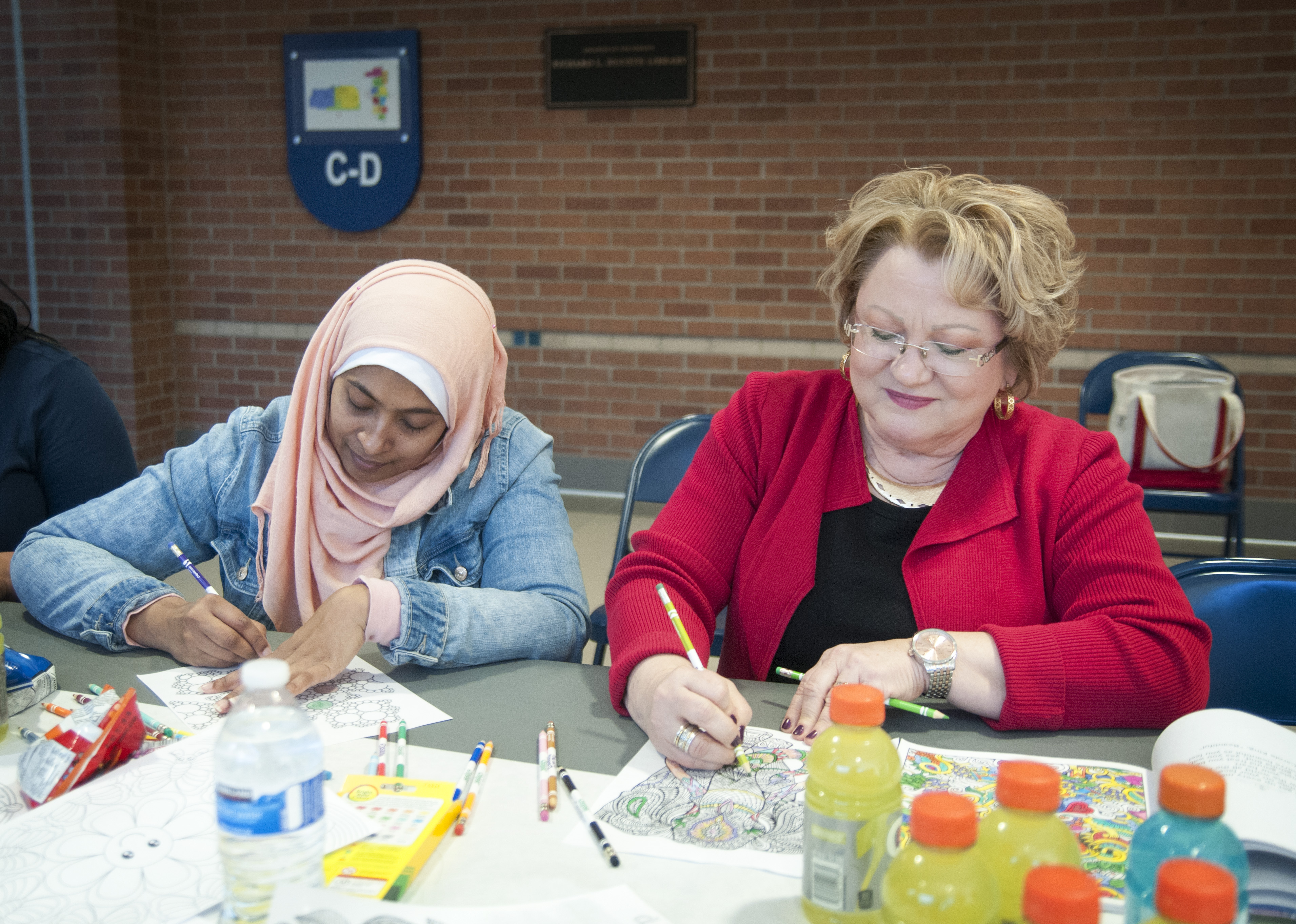 "Participants color mandalas during the ""Free Your Mind"" coloring event at Spring Creek Campus."